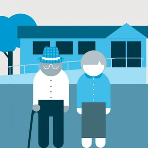 Two people standing outside a nursing home