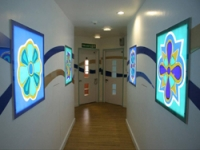 Large lightboxes recessed into the walls
