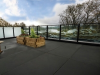 A balcony garden has been created with views of the surrounding landscape