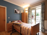 An ensuite room with French windows has been created