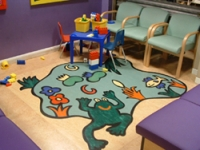 The waiting room now features a play area