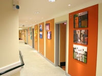 Pictures are hung on the colourful corridor walls