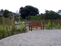 Seating, planting and paving feature in the new garden