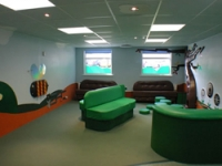 The waiting area provides plenty of room to play